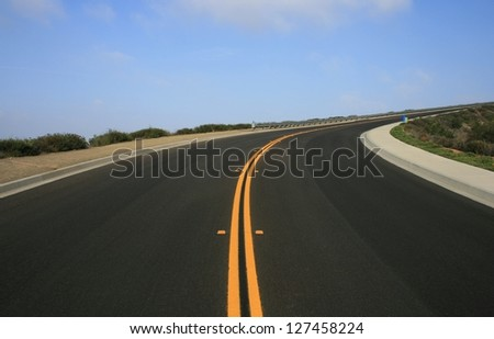 Paved road up a hill side, San Diego County, California - stock photo