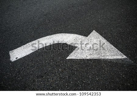 Pavement Arrow - Street Sign / Traffic Signage. White Arrow on Pavement.