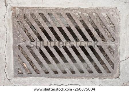 pavement drain - stock photo