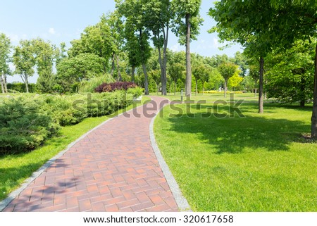 Pavement in the park - stock photo
