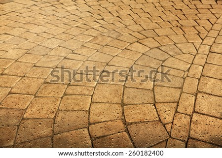 Pavement paved with cobblestone with water drops in grunge  - stock photo