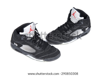 PAVIA, ITALY studio shot - APRIL 15, 2008 : a pair of vintage black Nike Jordan V on white background, product shot - stock photo