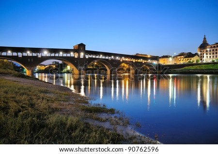 Pavia's covered bridge by night - stock photo