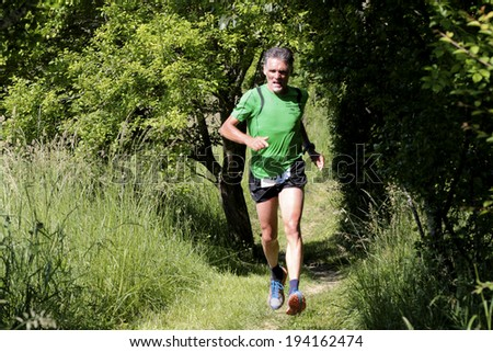 PAVIE, FRANCE - MAY 18: Portrait of a motivated runner at the Trail of Pavie, on May 18, 2014, in Pavie, France.  - stock photo