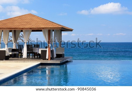 Pavilion and swimming pool near Atlantic Ocean, Dominican Republic - stock photo