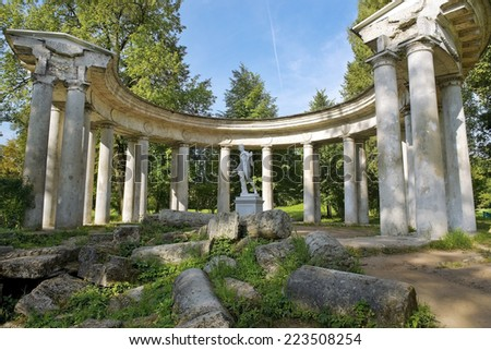 pavilion Apollo Colonnade with statue of Apollo Belvedere - roman marble copy of a bronze original of ancient Greek sculptor Leohara in Pavlovsk Park, Saint Petersburg, Russia - stock photo