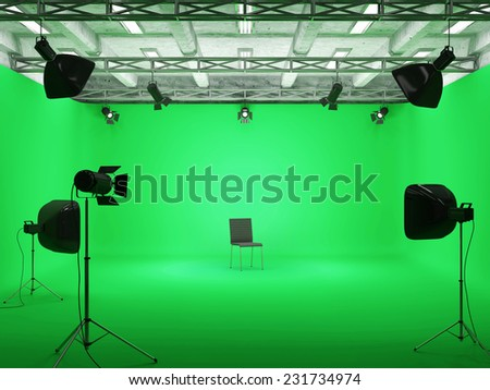 Pavilion Interior of Modern Film Studio with Green Screen and Light Equipment - stock photo