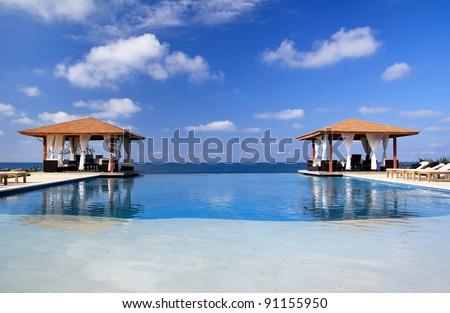 Pavilions and swimming pool near Atlantic Ocean, Dominican Republic - stock photo