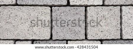 Paving blocks made of rectangular grey stones - stock photo