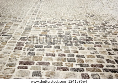 paving stone and snow - stock photo