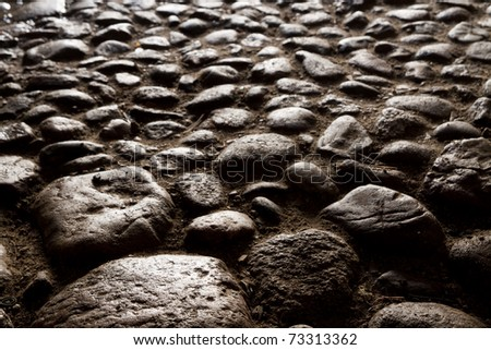 paving stones lighted by the evening sun - stock photo
