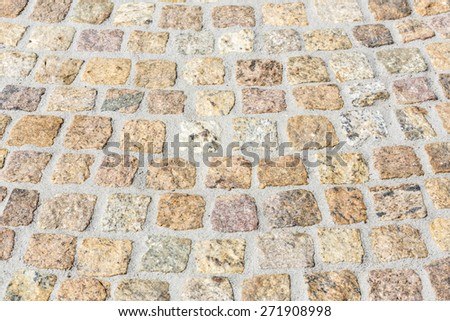 Paving works with new granite stones - stock photo