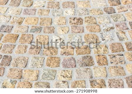Paving works with new granite stones - stock photo