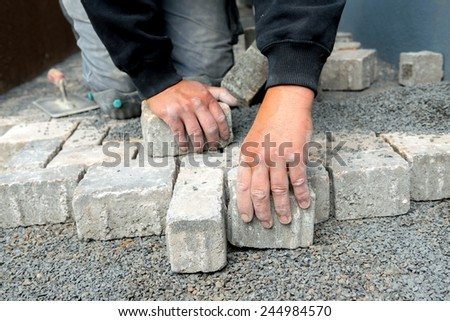 pavior is making anew gray way - stock photo