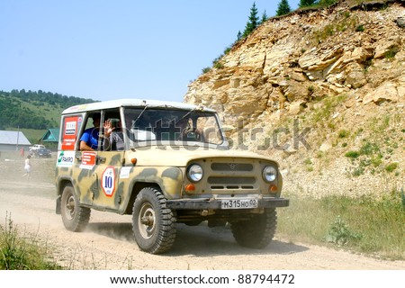 "PAVLOVKA, RUSSIA - JUNE 26: Off-road vehicle UAZ (No. 10) of Team ROTAS takes part at the annual trophy challenge ""23 hours of Nuriman"" on June 26, 2010 in Pavlovka, Russia."