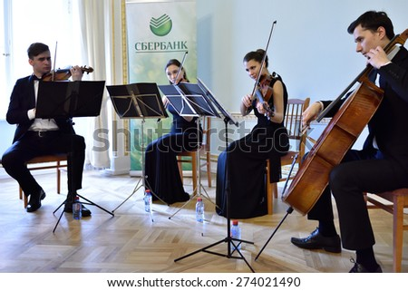 PAVLOVSK, ST. PETERSBURG, RUSSIA - APRIL 29, 2015: String quartet plays during the ceremony of the return of the marble vase stolen during the WWII to the State Museum-Reserve Pavlovsk - stock photo