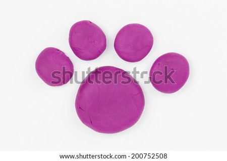 Paw from children bright plasticine - Stock Image macro. - stock photo