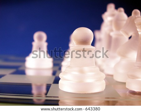 pawn in focus on chess board - stock photo