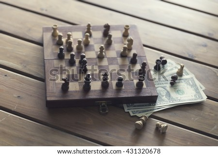 pawn of chess game and money banknote on wooden table for use in business competition concept, vintage tone and selected focus - stock photo