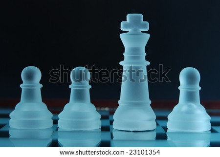 Pawns and king - stock photo