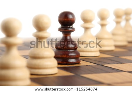 Pawns on a chess board - stock photo