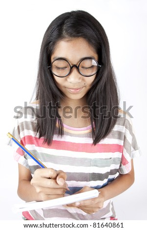 pay attention, Asian girl holding pencil writing on notebook studying.