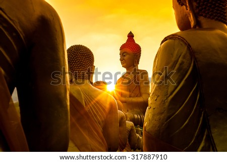 pay buddha in temple and beautiful sunset - stock photo