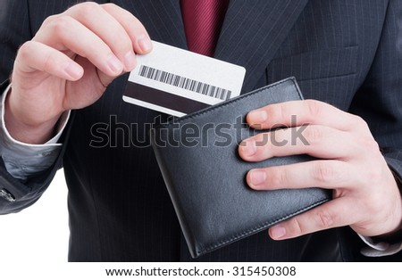 Pay by credit card concept or secure payment transaction with businessman, wallet and suit - stock photo
