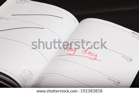 Pay day highlighted in a diary - stock photo