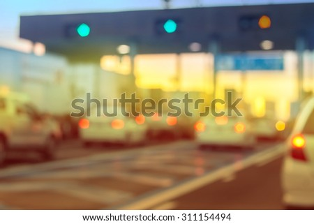 pay for using highway and motorway, abstract bokeh of light - stock photo