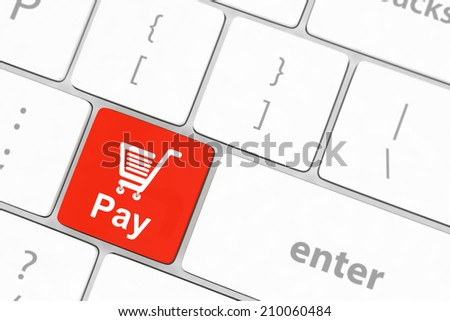 Pay key with shopping cart icon on a white keyboard - stock photo