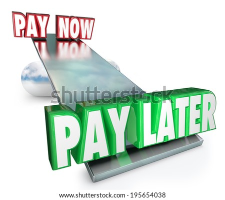 Pay Now Vs Later words on a see saw or balance borrow money or apply for credit - stock photo