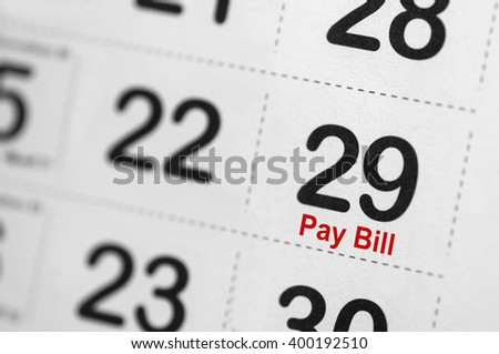 Pay of bill reminder on calender - Business Concept - stock photo