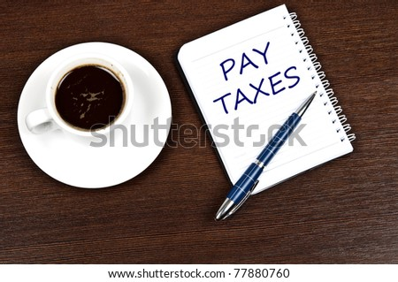 Pay taxes message and coffee
