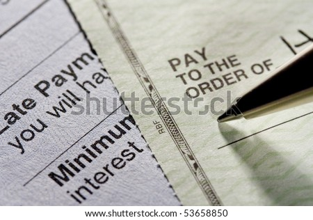Pay the bill. Shot with shallow depth of field. - stock photo
