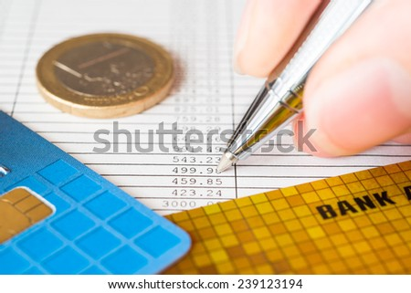 Pay the bills, bank card and pen with check on the table - stock photo
