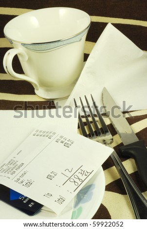 Pay the dinner bill in a restaurant - stock photo