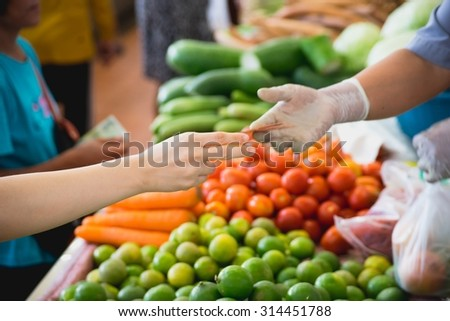 Pay vegetables. Different Fruits and vegetables at a street market in asia.