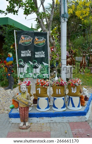 PAYAKKAPHUMPHISAI - APRIL 5 : Garden decoration in front of Cafe Amazon shop at PTT Oil station on April 5, 2015 in Payakkaphumphisai, Thailand. It's a famous franchise coffee house in Thailand.