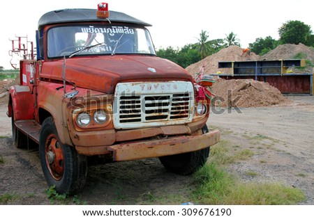 PAYAKKAPHUMPHISAI, MAHASARAKHAM - August 25 : Old municipality firetruck is dropped off at parking lots because of decadence on August 25, 2015 in Payakkaphumphisai, Mahasarakham, Thailand.