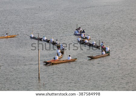 PAYAO,THAILAND-2016 FEB 22: Unidentified people on boats on Buddhist Lent Day or Rains-Retreat for the buddhist monks to dwell permanently at a suitable place throughout the rainy season.