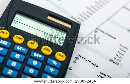 Paycheck, Calculator, Wages. - stock photo