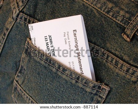 paycheck in jeans pocket - stock photo