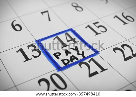 Payday concept. Calendar with blue felt pen background. Date in frame, close up