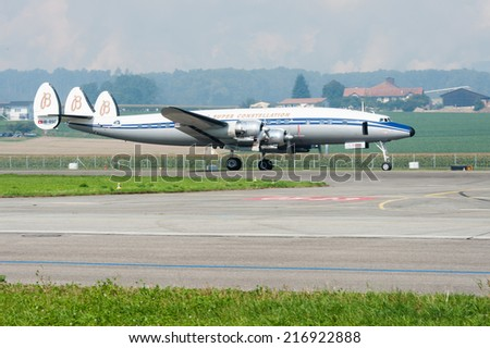 PAYERNE, SWITZERLAND - SEPTEMBER 7: Breitling Super Constellation on runway during AIR14 airshow in Payerne, Switzerland on September 7, 2014
