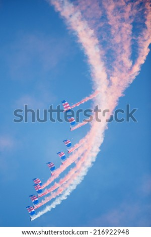 PAYERNE, SWITZERLAND - SEPTEMBER 7: Flight of Royal Air Force Falcons with parachutes in formation on AIR14 airshow in Payerne, Switzerland on September 7, 2014