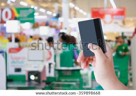 Paying credit card for purchases at the supermarket - stock photo