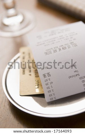 Paying Restaurant Bill With A Credit Card - stock photo