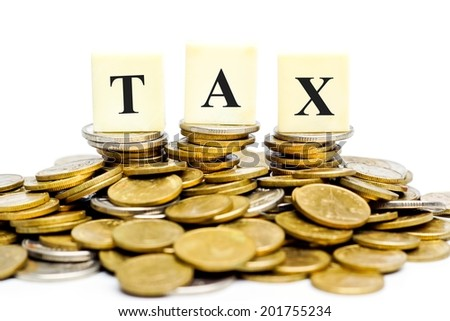 Paying tax - a pile of coins with the word tax