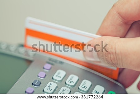 Paying with credit card on pos terminal - stock photo